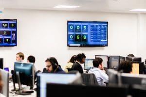 Team of skilled IT engineers working in office